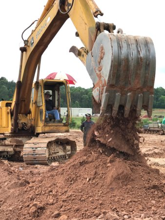 Morganton, GA: Getting instruction on how to operate the excavator.