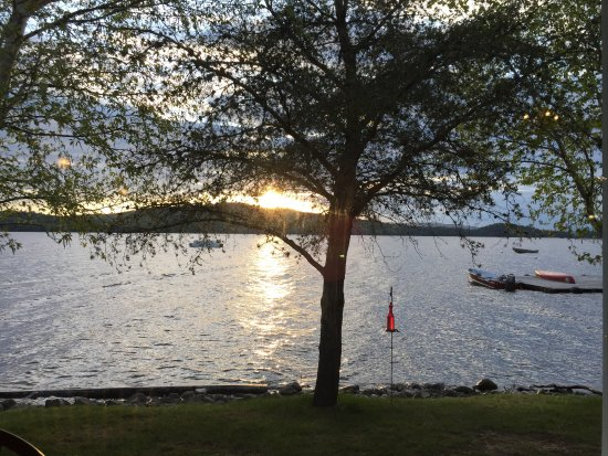 Oquossoc, ME: View from our dinner table looking out over the lake and sunset.