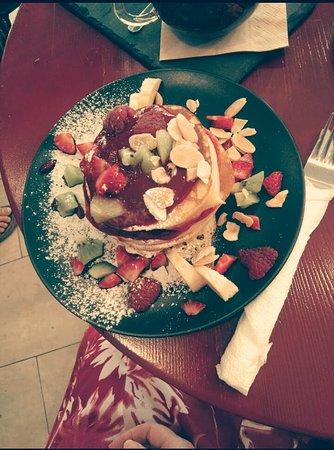 Pancakes with raspberry sauce.