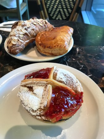 St Honore Bakery: incredible pastries including the blueberry tart in foreground and almond croissant in back