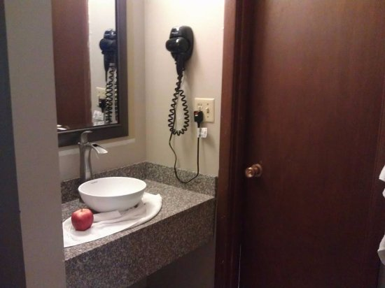 West Branch, IA: Vanity/sink outside shower and toilet. Sink too small, apple as reference.