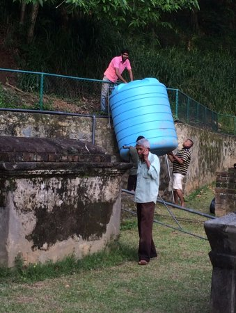 Kandy Garrison Cemetery: Mr Charles Carmichael, the caretaker, and some workers removing a water tank.