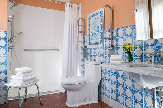 Sparrow Bush, NY: All of our bathrooms feature hand painted tiles, pictured is our handicap accessible bathroom.