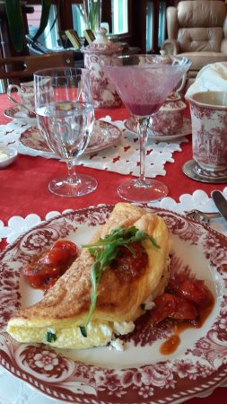 Auberge J.A. Moisan: breakfast setup at the sunroom- main: goat cheese and chive omelette souffle with tomato jam