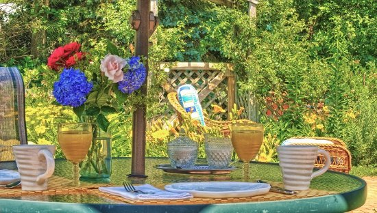 West Barnstable, MA: A table in the courtyard garden.