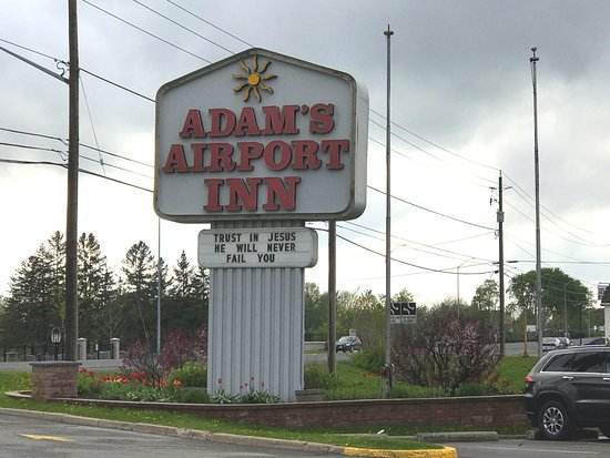 Adam's Airport Inn: The sign at the front tells of the faith the owners love to promote.