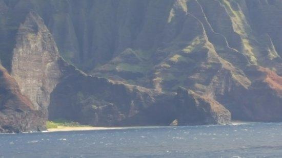 Na Pali Coast : Secluded beaches adjoined by an arch. Na Pali, Kauai.