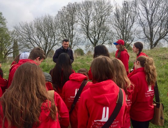 The Salient Tours Guide Luc with our students at the Essex Farm Cemetery - Credit: Hanna Smyth