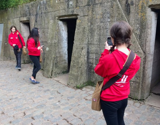 Our students at the Essex Farm Cemetery, one of their stops with Salient Tours - Credit: Hanna S