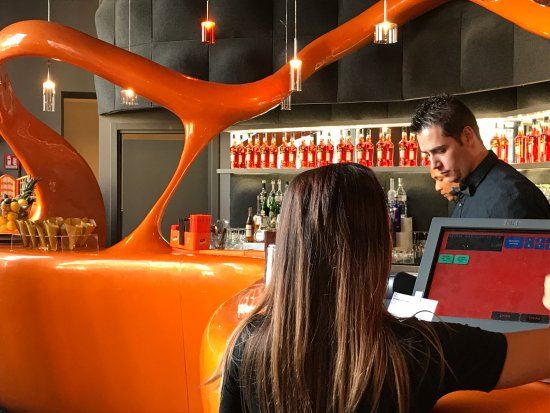 Making The Aperol Magic Happen At The Aperol Colored Bar