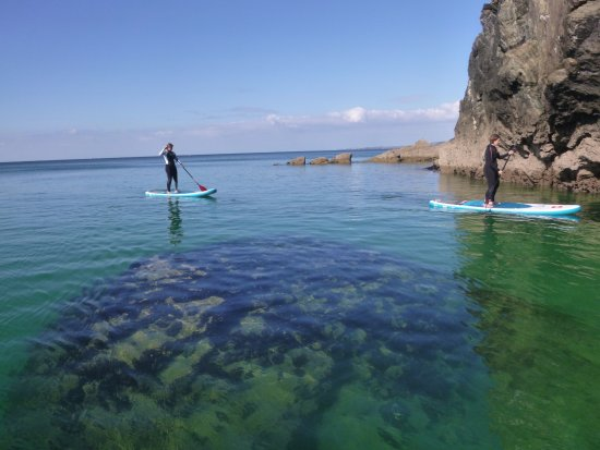 St Agnes, UK: SUP Newquay, Cornwall enjoy crystal clear waters