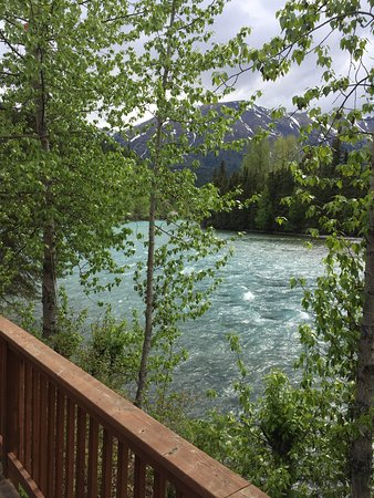 Kenai Riverside Lodge: View from lodge deck with a fire pit and plenty of seating for relaxing