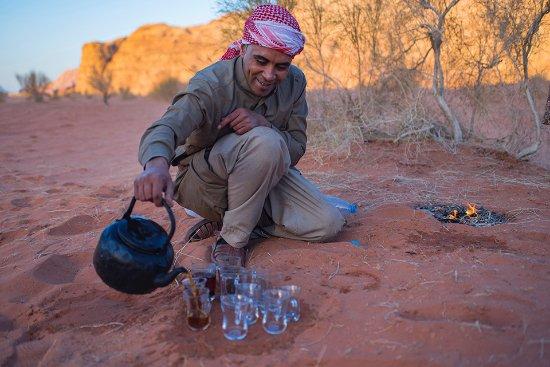 Monaco Business Development : bedouin eat in the desert of wadi rum at sunrise