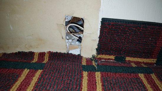 Seneca Falls, NY: Exposed wiring and frayed carpet