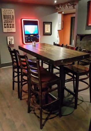 The Rad Brothers Sportsbar and Taphouse: Have a seat by our JukeBox and your the DJ for the Night.