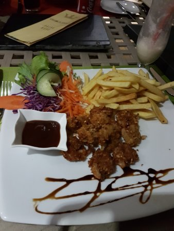 Crown Beach Hotel : Coconut breaded prawns with fries and salad