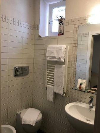 small, modern bathroom - picture of hotel dell'orologio