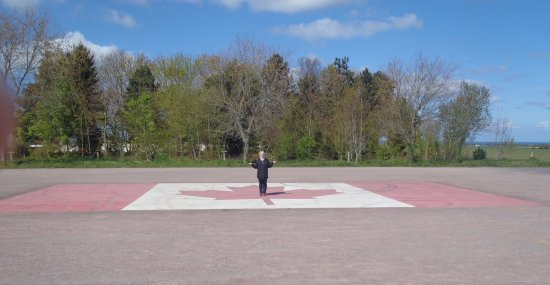 Reviers, Francja: A huge Canadian flag covers the parking lot.