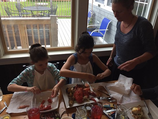 Round Pond, ME: Andrea helping our kids shuck a lobster for the first time