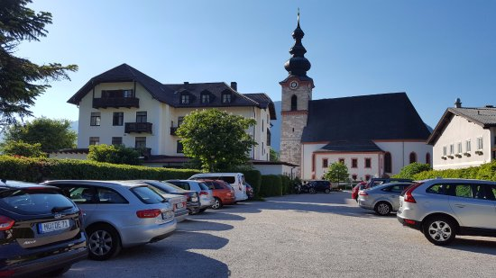 Grossgmain, Austria: Hotel with village clock tower behind
