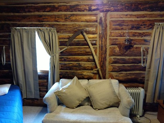 Midnight Sun Log Cabins: I was taking a picture of the scythe so he picture doesn't show a full view of the room with 2 b