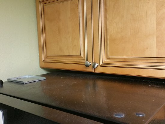 Dirty, worn couch. Cabinets and fridge not cleaned. - Picture of ...