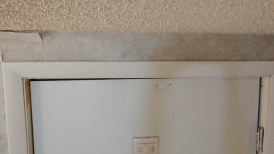 Perrysburg, OH: Peeling wallpaper by door