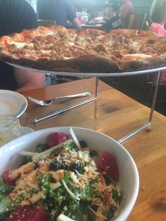 Kittery, ME: Kale salad and Mama's lil pepper and Italian sausage wood fired pizza. Yum!