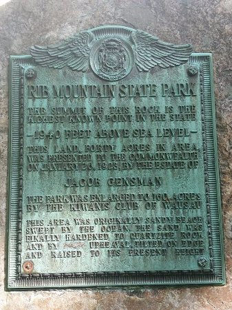 Wausau, WI: A plaque on one of the boulders that describes the park. (don't know which word was removed)
