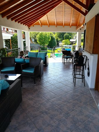 Veronica Studios: View from the rear of the pool bar area looking out towards the pool & gardens