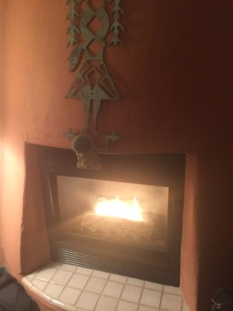 "Southwest Inn at Sedona: The fireplace (with ""Squirtle"" who travels with us on trips!)"