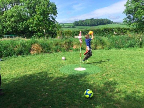 St Austell, UK: grandson playing football/golf