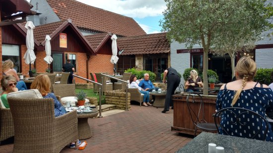 Southwell, UK: Tea room in the summer, showing g outdoor seating.
