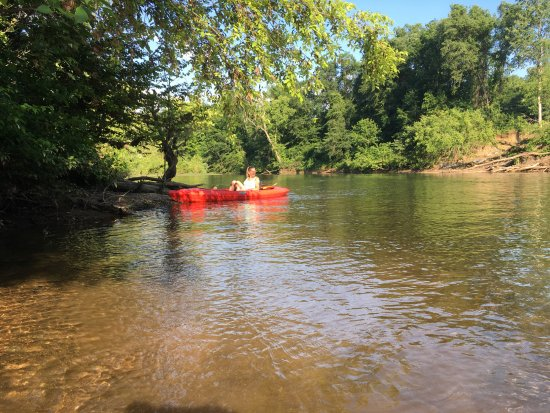 McMinnville, TN: One of the crew prepare to dock kayak at Smooth Rapids.