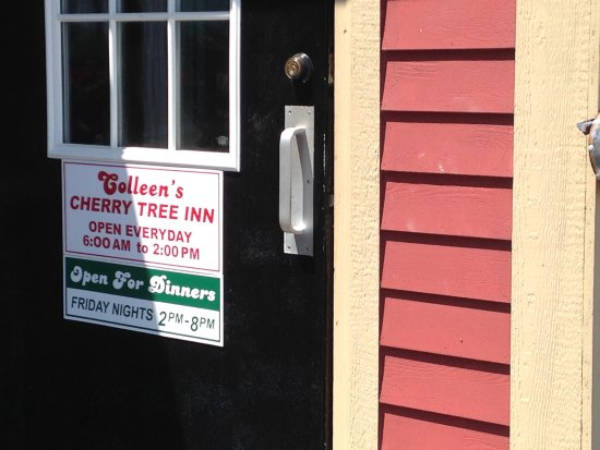 Henderson, NY: Front door with times when serving.
