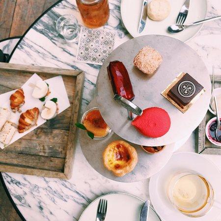 Afternoon tea set: Eclair, macaroon, chocolate cake, coconut financier
