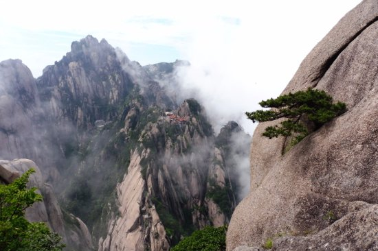 Celestial Capital Peak (Tian Du Feng): Lotus Peak and YuPingLou Hotel from just above the 75-degree steps on Tian Du Feng.