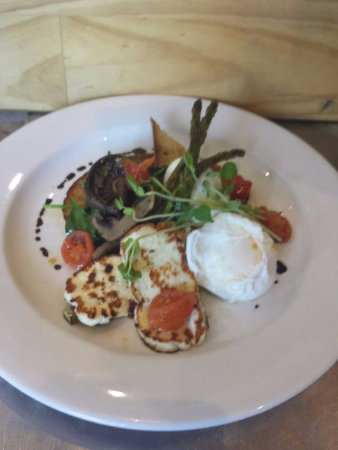 Helensvale, Australia: organic sourdough, spinach, mushrooms, grilled asparagus, poached egg:s, haloumi and confit toma
