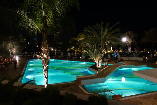 Constantinou Bros Athena Royal Beach Hotel: One pool at night from drinks balcony