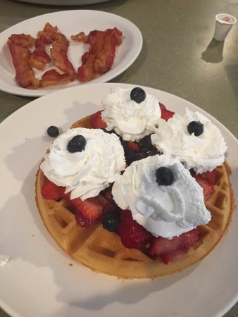 Haverhill, MA: side of bacon 7 Waffle with Strawberries , Blueberries and Whipped cream