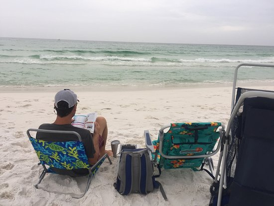 Henderson Beach State Park Campground: Set up for a day at the beach. Husband is reading the Destin travel brochure