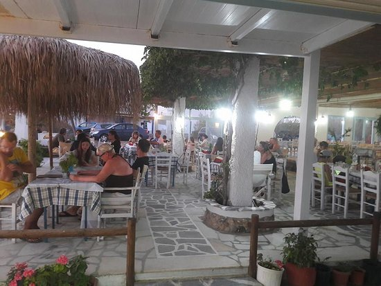 The customers enjoy the food and relax with the view of the sunset.