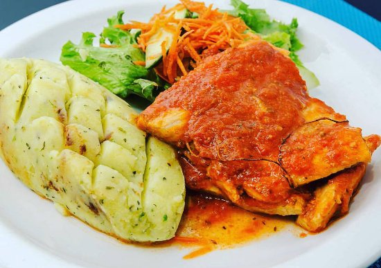 Holetown, Barbados: Bajan Style Fish served with garlic mashed potatoes and a side salad
