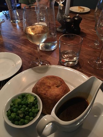Fairford, UK: Rabbit and chicken pie with house wine. Sleeping fireplace dog.