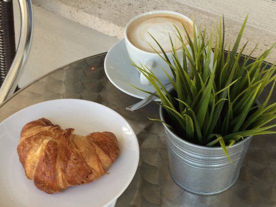 By-The-Bay BISTRO: Dining outside with croissant and latte