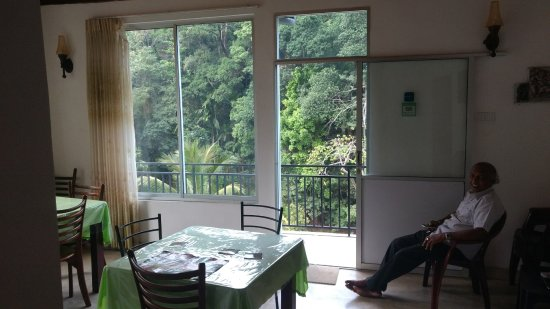 Green Villa Kandy: The dining area on the top floor, with Mr. Medis, as always, in good spirits