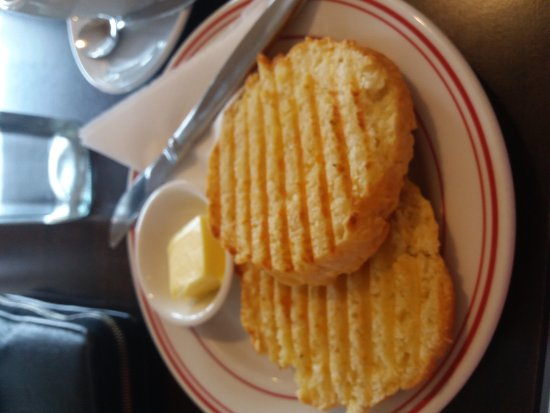 Tawa, Nya Zeeland: Delicious cheese scone warmed on grill. Enough butter for a generous serve. Would visit again fo