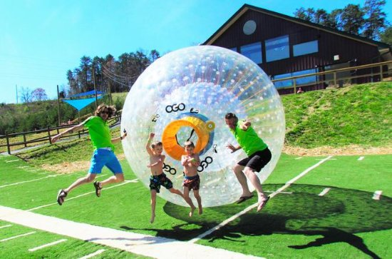 Zorbing at Outdoor Gravity Park in...
