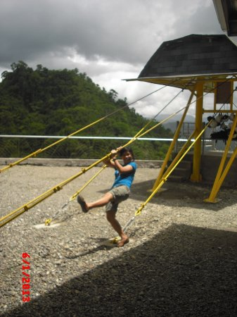 Sogod, Philippines: one of our girls @ the top of the hill...hanging on the cable wires