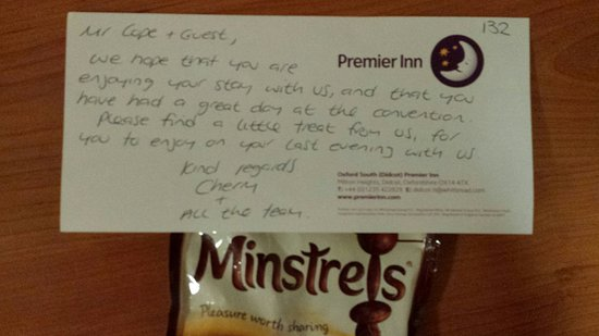 Milton, UK: The note and chocolates we received from the manager.